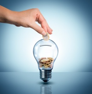 invest to energy concept - euro in bulb - piggybank